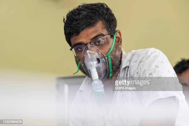 Patient has been given oxygen mask due to breathing problem in Barasat Govt hospital of Kolkata. The record One-Day COVID-19 Deaths in India are...