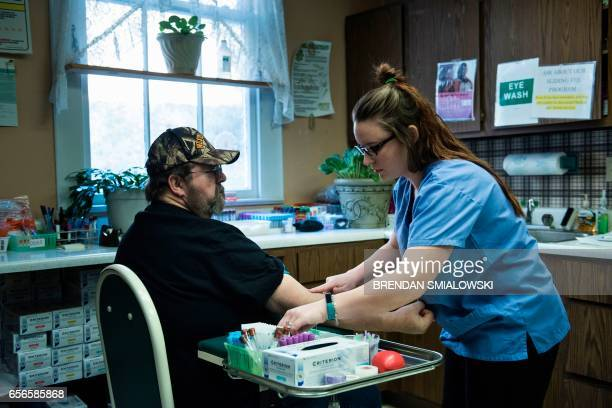 A patient has blood drawn at the Community Health Center of NE Wetzel County March 22 2017 in Burton West Virginia The Republicancontrolled House of...