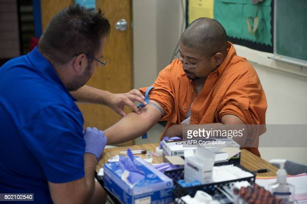 A patient has blood drawn for lab tests at Greensville County High School in Emporia Virginia June 25 where Remote Area Medica l a nonprofit...