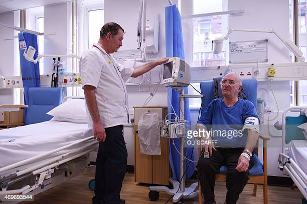 A patient has his blood pressure measured in the Accident and Emergency department of the 'Royal Albert Edward Infirmary' in Wigan north west England...