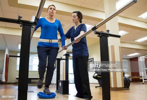 patient having physical therapy in hospital - recovery stock pictures, royalty-free photos & images