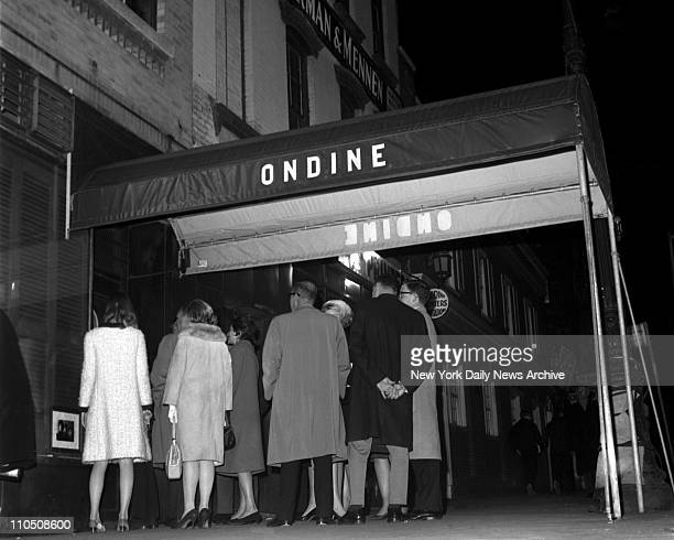 Patient hopefuls wait outside Ondine Club for departures to make room inside