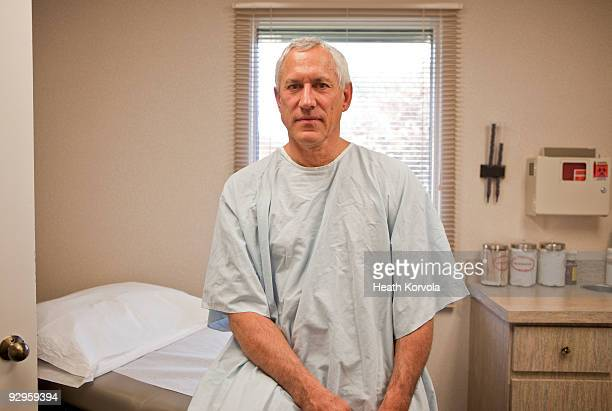patient in examining room. - examination table stock pictures, royalty-free photos & images