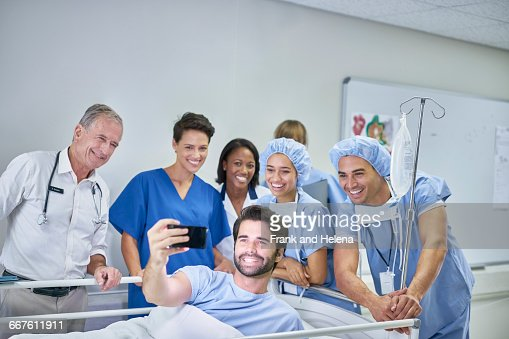 Patient In Hospital Bed Taking Selfie With Doctors And Nurses High Res Stock Photo Getty Images