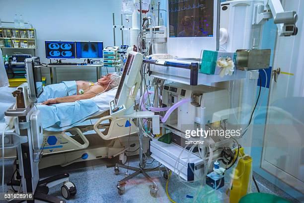 patient in operating theatre - hospital machine stock photos and pictures
