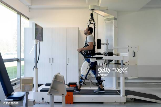 patient in physical therapy doing exercises with an exoskeleton - limb body part stock pictures, royalty-free photos & images