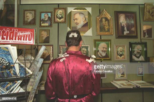 A patient in the library at the San Giovanni Rotondo hospital founded by Padre Pio