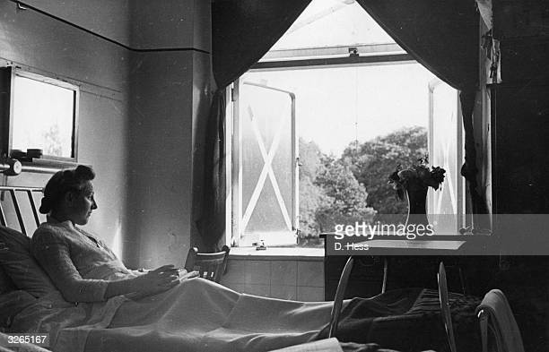A patient in the tuberculosis convalescent home at Paddington London enjoying the view from her window