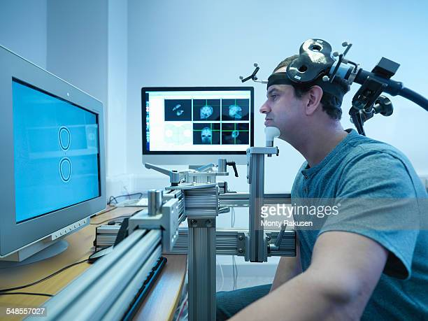 Patient in transcranial magnetic stimulation (TMS) experiment