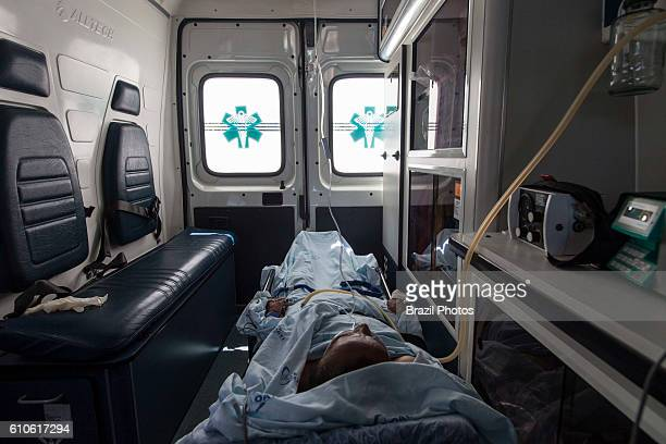 Patient inside an ambulance, a vehicle for transportation of sick or injured people to, from or between places of treatment for an illness or injury,...