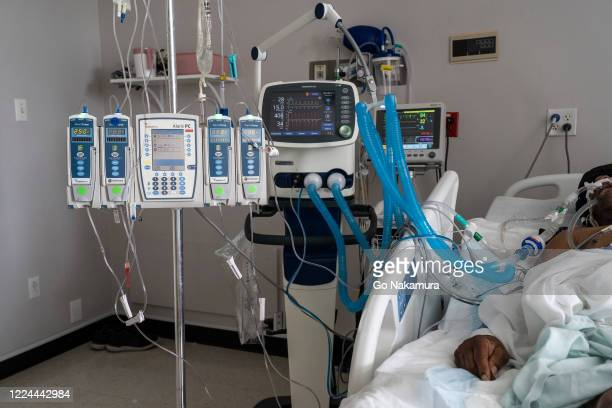 A patient is connected to a ventilator and other medical devices in the COVID19 intensive care unit at the United Memorial Medical Center on July 2...