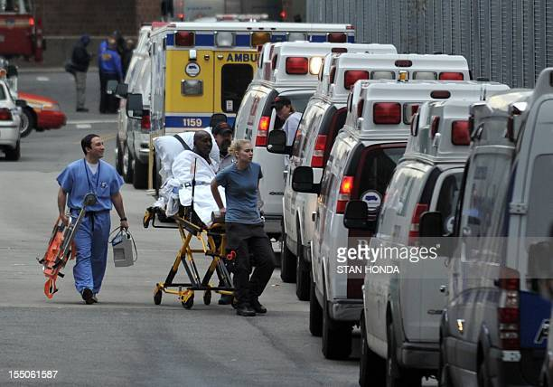 A patient is evacuated from Bellevue Hospital on October 31 2012 in New York The hospital had been operating on backup generators since losing power...