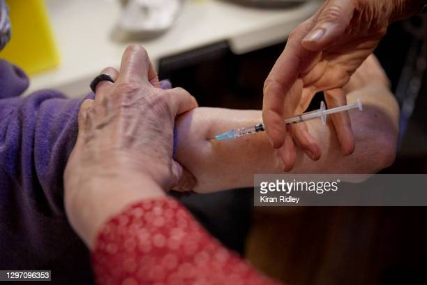 Patient is injected with a Pfizer BioNTech Covid-19 vaccine at a vaccination centre in the 3rd arrondisement on January 18, 2021 in Paris, France. As...