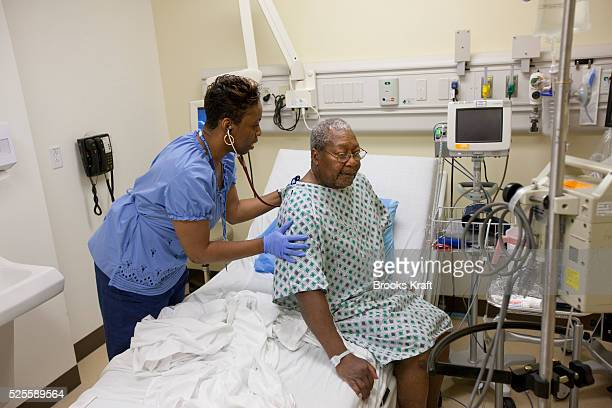 A patient is monitored in an examination room inside the Clinical Decision Unit at Kaiser Permanente's Capitol Hill Medical Center in Washington DC...