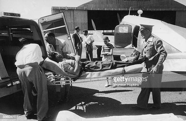 A patient is put into an ambulance on a stretcher after being flown from the Australian outback by the Flying Doctor Service The service is a private...