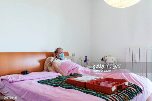 Patient is seen in his bed during the Italian Red Cross's visits to COVID-19 positive patients on April 3, 2020 in Bergamo, Italy. The number of new...