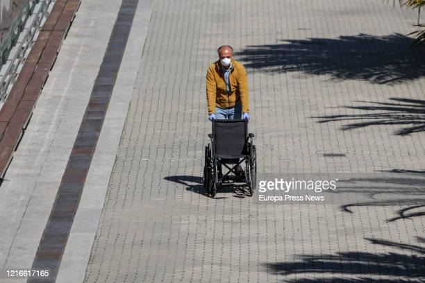 A patient is seen walking at the surroundings of the campaign hospital of IFEMA established to help during the infection admitting coronavirus...