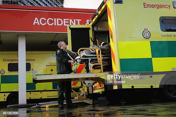 A patient is taken from an ambulance outside the Accident and Emergency ward at St Thomas' Hospital on January 6 2015 in London United Kingdom...