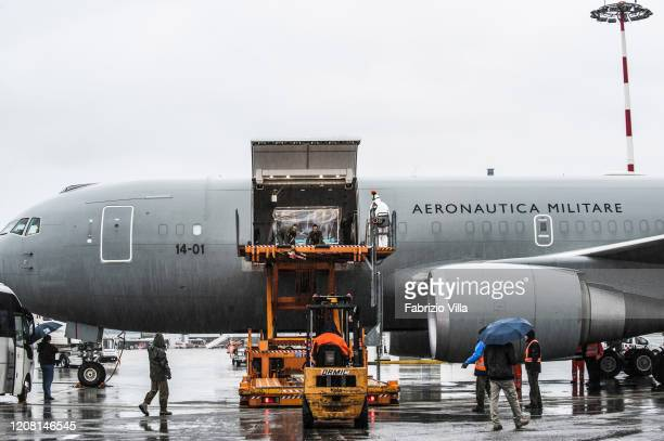 A patient is taken off a Boeing KC767 during a military exercise between Rome and Milan in which it was simulated the air transport of a patient...