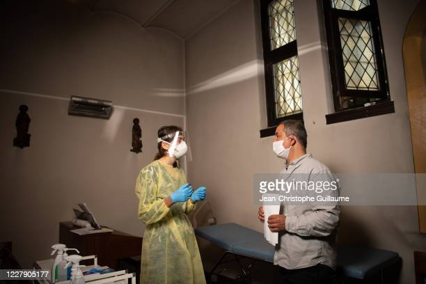 Patient is tested at The Sint Rochus Catholic Church in Deurne which has been transformed into a covid-19 testing center for the people of Antwerp on...