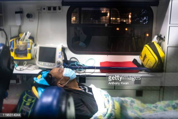 A patient is transferred by an ambulance to the Infectious Disease Centre of Princess Margaret Hospital on January 22 2020 in Hong Kong China Hong...