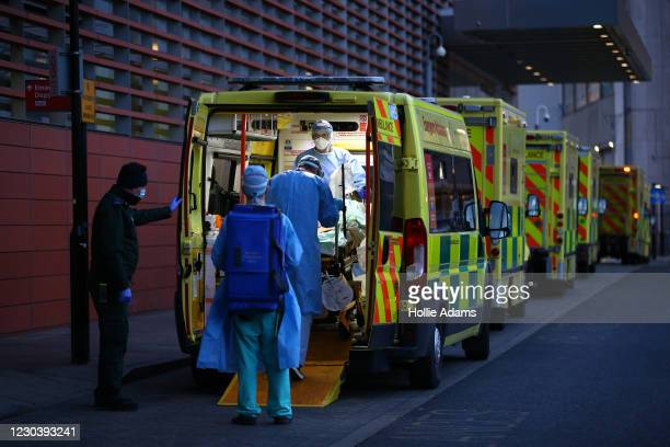 Patient is transported out of an ambulance by medics at the Royal London Hospital on January 2, 2021 in London, England. As of December 28th, NHS...