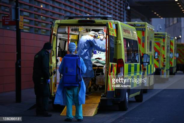 Patient is transported out of an ambulance by medics wearing PPE at the Royal London Hospital on January 2, 2021 in London, England. As of December...