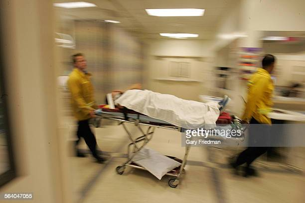 A patient is wheeled into the emergency room at the Downey Regional Medical Center emergency room on 10/6/2006Downey and other nearby hospitals are...
