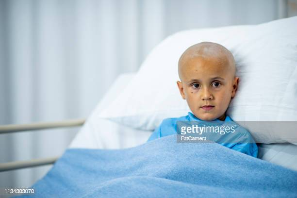 patient laying in bed - leukemia stock pictures, royalty-free photos & images