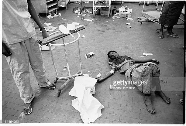 Patient laying on the floor of Mogadishu's central hospital which is overwhelmed by casualites from the fighting, October 1993.