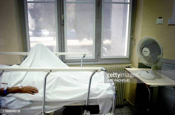 A patient lays in a hospital bed 26 July 2006 in the emergency ward of Edouard Herriot hospital in Lyon Europe baked again today under a relentless...