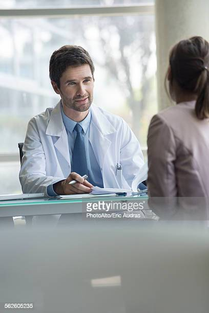 Patient listening as doctor explains test results