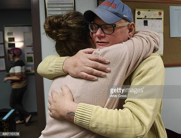 AIDS patient Louis Ruhlin right hugs Rocky Mountain CARES medical care manager Lauren Hollis BSW at Rocky Mountain CARES after an appointment...