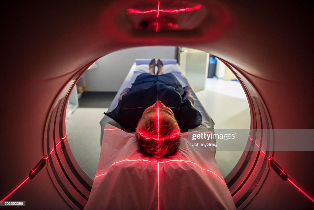 Patient lying inside a medical scanner in hospital : Stock Photo