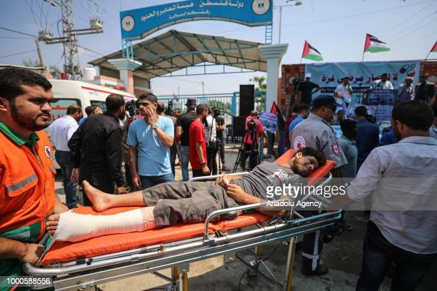A patient lying o a stretcher takes part in a protest against the impairment of health due to Israel's over a decade long blockade in front of Beit...