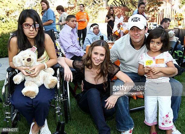 Patient Margaret Roa actress Jennifer Love Hewitt actor Ross McCall and Kiana Roa attend a Halloween party at Childrens Hospital Los Angeles hosted...