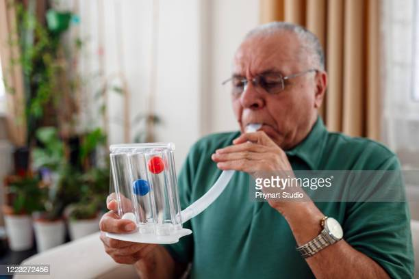 patient measures his own lung capacity - heart disease stock pictures, royalty-free photos & images