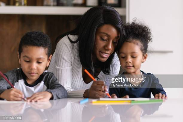 a patient mother homeschool during a pandemic - homeschool stock pictures, royalty-free photos & images