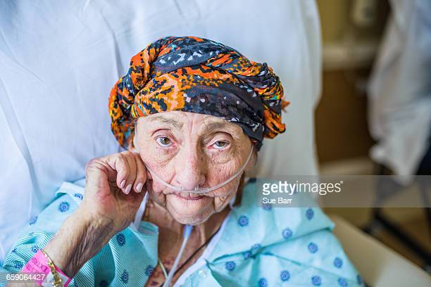 patient on hospital bed, close up - old woman in sick bed stock photos and pictures