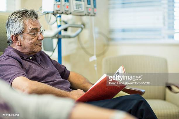 Patient reading book in infusion room
