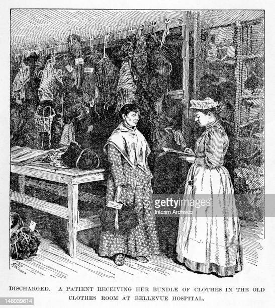 A patient receives her bundle of clothes in the old clothes room while a nurse assists in discharging her from Bellevue Hospital New York City late...