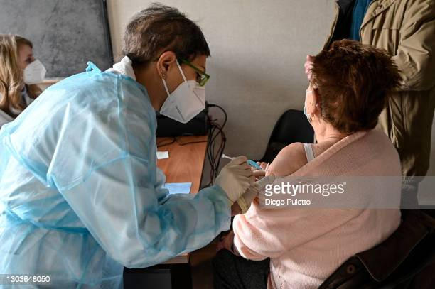 Patient receives the Pfizer-BioNTech COVID-19 vaccine in the Moncalieri hospital on February 23, 2021 in Turin, Italy. The main state workers...