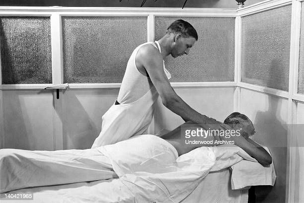A patient receiving a Swedish massage at the Kellogg's Battle Creek Sanitarium Battle Creek Michigan 1930