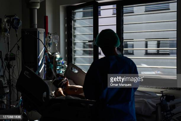 Patient rest on the bed next to a window at the ICU of Krakow University Hospital on September 04, 2020 in Krakow, Poland. Poland has banned flights...