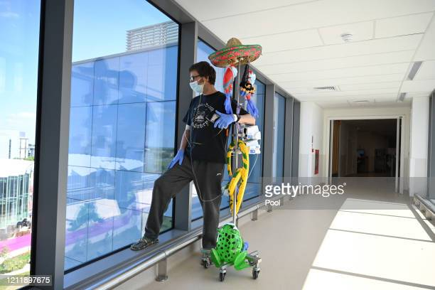 Patient Richard Priest who is waiting for a heart transplant wears a mask as he walks with his decorated IV drip at a shielding ward at Royal...