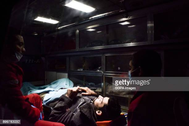 DOUMA DOUMA SYRIA DAMASCUS SYRIA A patient seen being placed inside an ambulance The evacuation of two wounded in the eastern Ghouta besieged the...