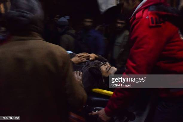 DOUMA DOUMA SYRIA DAMASCUS SYRIA A patient seen inside an ambulance being taken care by medical staff The evacuation of two wounded in the eastern...