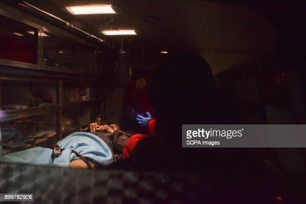 DOUMA DOUMA SYRIA DAMASCUS SYRIA A patient seen inside an ambulance being taken care by medical staffs The evacuation of two wounded in the eastern...