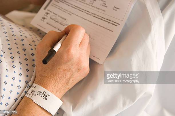 patient signing paperwork - bracelet photos stock pictures, royalty-free photos & images