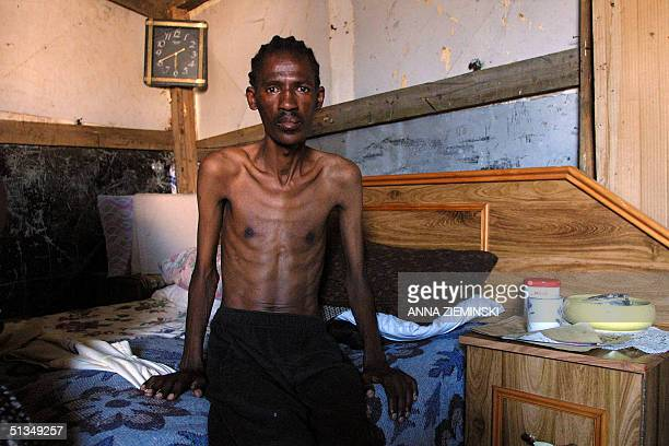 AIDS patient Sindile Mayezana sits on his bed in his shanty in Duncan Village East London 12 August 2002 Although AIDS patients are often shunned by...